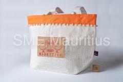 GV041-Gavik-jute-bag-with-blue-border-decoration-ball-and-print-Gavik-Company-Ltd-Mr.Gabriel-Kamudu-Tel-4640329-52542480-gavikcoltd@gmail.com_